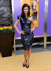 Tena Desae simply sparkled in her sapphire blue sequin cocktail dress.