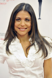 Bethenny Frankel wore her glossy locks with a casual center part at the launch of Skinnygirl Daily