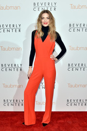 Jaime King arrived for the Beverly Center renovation announcement event looking bright in a red-orange Tory Burch jumpsuit.