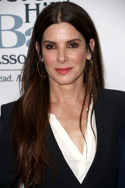 Sandra Bullock sported casual center-parted tresses at the 2018 Entertainment Lawyer of the Year dinner.