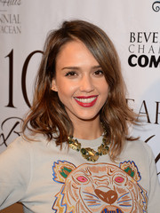 Jessica Alba topped off her busy-looking ensemble with a gold collar necklace.