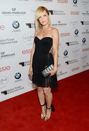 Mena Suvari wore these gold lace-up pumps with her soft LBD.