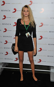 Tamsin Egerton showed a leg wearing a quarter-sleeved mini dress at the Beyonce 4D with Belvedere event.