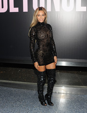 Beyonce Knowles' thigh-high black peep-toe boots echoed the style of her dress.