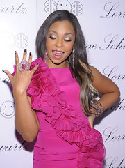 Ashanti toned down her hot pink ruffled dress with gunmetal nails while attending a launch party. The singer knows how to add a little sizzle to her look.