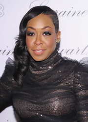 Tichina Arnold's side sweep at the 2BHappy Jewelry collection launch was more edgy than romantic.
