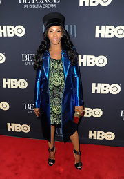 June Ambrose flaunted her feet in a pair of strappy sandals at Beyonce's HBO documentary premiere.