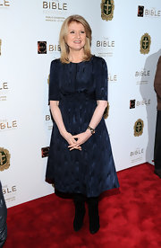 Arianna Huffington wore a sleek navy cocktail dress for her red carpet look at 'The Bible Experience' opening.