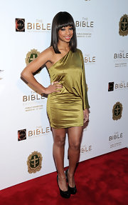 Monique Coleman sported a metallic one-shouldered dress while at 'The Bible Experience' opening gala.