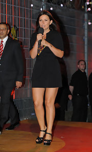 Davina McCall's black platform sandals looked perfect with her romper on the set of 'Big Brother.'