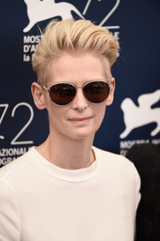 Tilda Swinton accessorized with a pair of ultra-modern shades for added coolness.