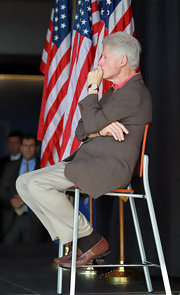 Bill Clinton looked deep in thought as he showed off a classic leather band watch, befitting of the former president.