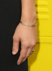 This delicate bracelet features gold and silver.