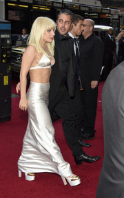 Lady Gaga teetered on chunky white and gold platform pumps as she made her way to the Billboard Women in Music event.