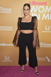 Ashley Graham turned heads in a black Christian Siriano crop-top with sheer leopard-print sleeves at the 2018 Billboard Women in Music event.