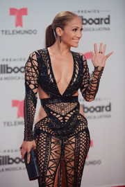 Jennifer Lopez paired a blue Jimmy Choo tube clutch with a barely-there dress for the Billboard Latin Music Awards.