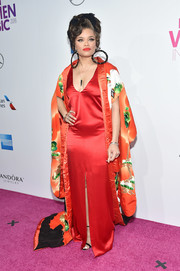 Andra Day sported a slinky red satin gown at the Billboard Women in Music 2016.