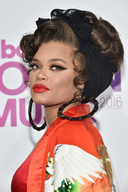 Andra Day topped off her look with a voluminous retro updo when she attended the Billboard Women in Music 2016.