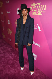 Kelly Rowland went the menswear-chic route with this navy pinstriped pantsuit by Tibi at the 2017 Billboard Women in Music event.