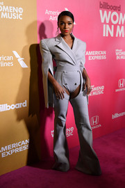 Janelle Monae grabbed attention in a bold-shouldered peekaboo jumpsuit by Gareth Pugh at the 2018 Billboard Women in Music event.