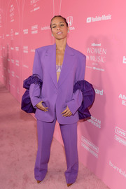 Alicia Keys chose a purple Prabal Gurung pantsuit with ruffle accents on the sleeves for the Billboard Women in Music 2019.