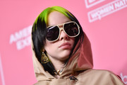 Billie Eilish accessorized with gemstone chandelier earrings for a glam touch to her look during the Billboard Women in Music 2019.