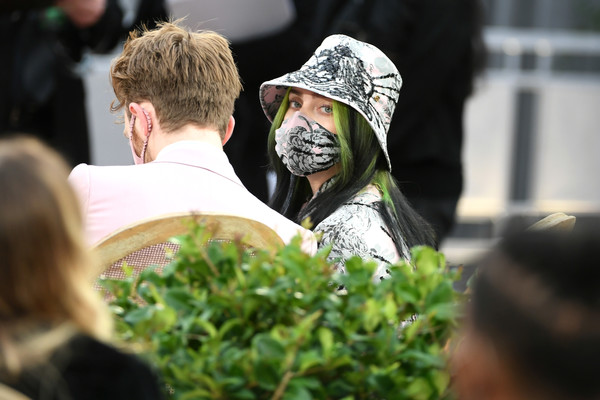 Billie Eilish Bucket Hat [plant,cap,grass,eyewear,happy,event,crowd,recreation,personal protective equipment,baseball cap,billie eilish,crowd,telecast,grass,eyewear,recreation,los angeles convention center,california,annual grammy awards,event,headgear,tree]