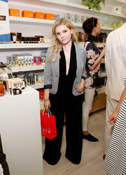 Abigail Breslin tempered her sexy black jumpsuit with a gingham blazer during the Birchbox flagship store opening.