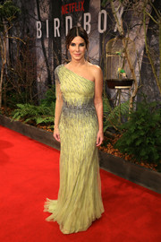 Sandra Bullock made a regal statement in a bedazzled citrine one-shoulder gown by Alberta Ferretti at the European premiere of 'Bird Box.'