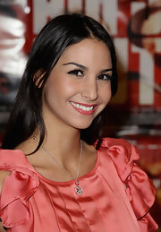 Sila Sahin looked so sweet with her heart pendant necklace and ruffle blouse.