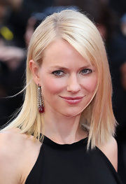 Naomi Watts hasn't missed a beat while in Cannes. She topped her decadent look off with a sleek shoulder-length crop.