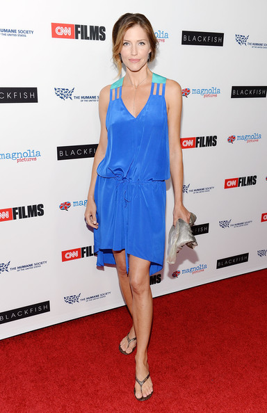 Tricia's draped baby blue dress featured teal shoulder straps for an extra pop of color.