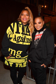 Janet Jackson matched Queen Latifah's sporty style with a black hoodie.