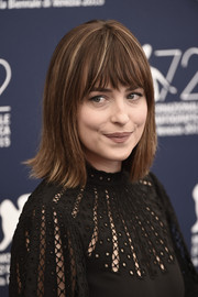 Dakota Johnson pulled off this casual flip with wispy bangs at the 'Black Mass' photocall.