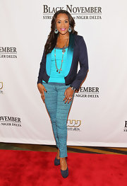 Vivica A. Fox was a sexy sight in an ensemble featuring multiple shades of blue. She completed her look with a great pair of dusty blue suede pumps.