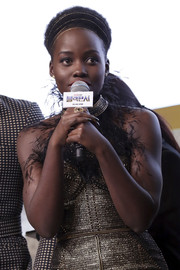 Lupita Nyong'o jazzed up her look with a gold multi-strand headband for the Seoul premiere of 'Black Panther.'