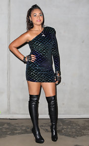 Jessica went a little over the top with costume lashes, studded fingerless gloves and over the knee boots with her geometric-patterned one=sleeve mini dress.