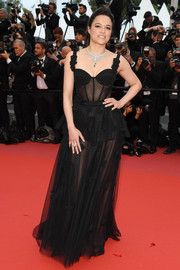 Michelle Rodriguez went for a sultry look in a sheer black corset gown at the Cannes Film Festival screening of 'BlacKkKlansman.'