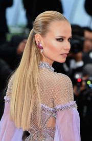 Natasha Poly styled her hair into a sleek half-up 'do for the Cannes Film Festival screening of 'BlacKkKlansman.'