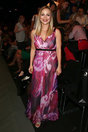 Regina Halmich wore a pink abstract-print maxi dress at the Blacky Dress runway show.