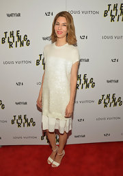 Sofia stuck to a crisp ivory beaded dress that featured a tiered skirt and beaded front panel.