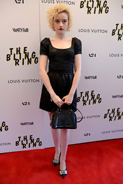 Julia Garner's fitted embossed leather dress mixed edgy and flirty styles.