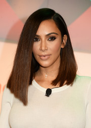 Kim Kardashian styled her outfit with a simple cross pendant.