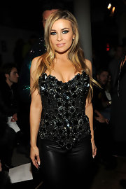 Carmen Electra may have opted for an all-black look at The Blonds runway show, but she spiced the look up with a rhinestone and jewel embellished corset top.