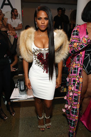 Christina Milian was hard to miss at the Blonds fashion show in this cleavage-baring, body-con dress embellished with a cross and a bleeding heart.