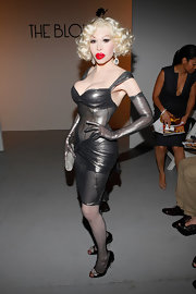 Amanda Lepore stepped out at the 2012 Fashion Week wearing a gray leather dress.