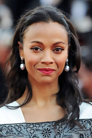 Zoe Saldana opted for naturally wavy locks with a tiny braid at the crown for her look at the 'Blood Ties' premiere in Cannes.