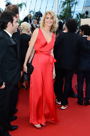 Alice Taglioni chose a flowing red gown with a wrap detail and V-neck.