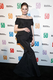 Coco Rocha was a goth beauty in a black off-the-shoulder mermaid gown at the Bloomberg 50 celebration.