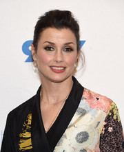 Bridget Moynahan wore her hair in a casual, mildly messy updo at the 'Blue Bloods' 150th episode celebration.